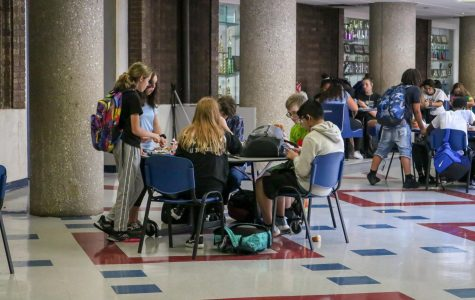 Michelle Sass and Teagan Lienen standing during D lunch on September 12th, 2019. There are currently not enough seats and tables for students to sit and eat lunch. Some students are either stuck standing at a table or at a counter area.