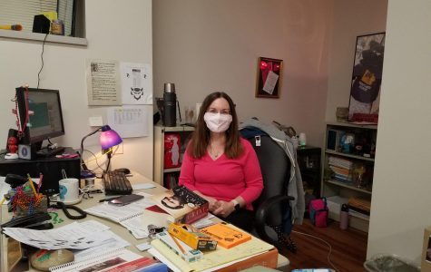 Mrs. Beuning sitting at her desk during class Photo cred: La Della Gallagher