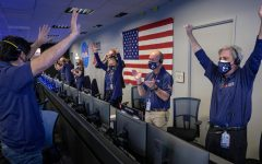 Mission Control cheers as Perseverance makes its landing