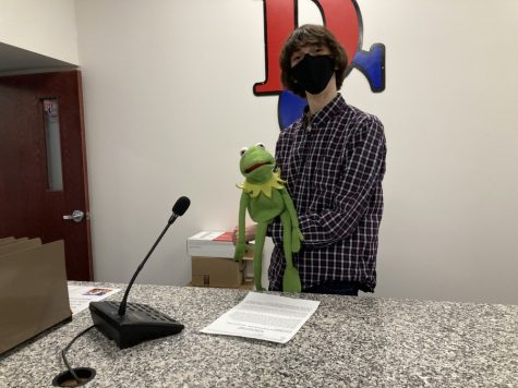 Wyeth Platt and Kermit stand ready to inform the school of the news